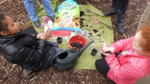 Making seed bombs - more purposeful than most mud pies, but just as much fun.