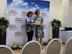 Receiving our London in In Bloom - outstanding award